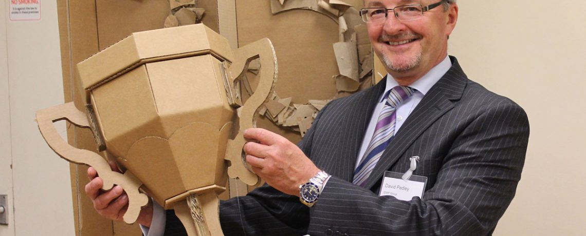 David Pedley with a cardboard trophy, created to celebrate GWP's 25 years in business