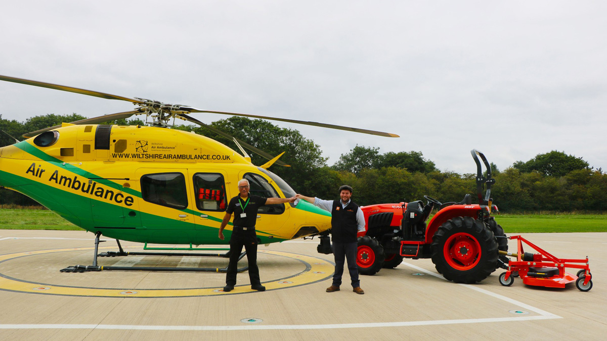 Jason Howard (right) from Howard & Sons hands over the keys to Wiltshire Air Ambulance's Neil Freegard